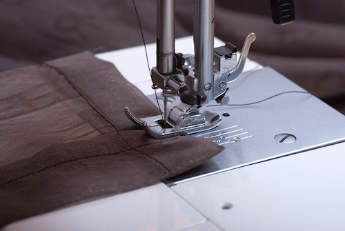 an electric sewing machine creating a new set of curtains