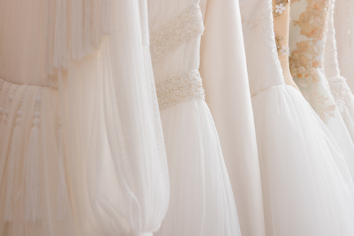 close up of many wedding dresses