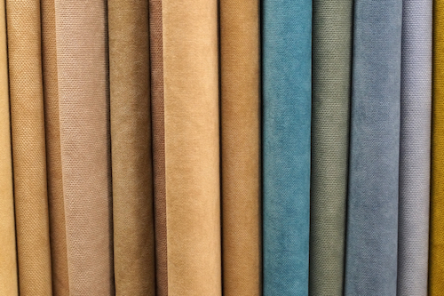 a photo of reams of different colours of curtain material